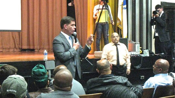 Mayor Marty Walsh fielded many questions Monday at a Roxbury town hall meeting. Attendees wishing to ask questions submitted their ...