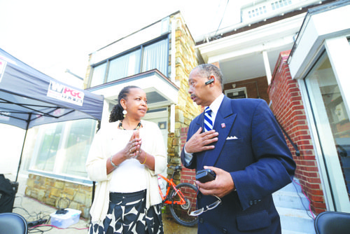 "Washington Informer Publisher Denise Rolark Barnes talks with the Rev. Anthony Motley during the kickoff of the ""95 Days of Peace"" campaign, sponsored by 95.5 FM (WPGC). The station broadcast live outside of The Informer's offices on May 22."