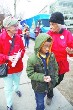 Aurelia Clifford (left), 87, Margaret Labat, 84, and Margaret's grandson Sean Holmes, 11, chatted while they walked throughout Ward 7 during the block-by-block Age-Friendly DC Initiative earlier this spring.