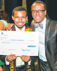 Kwari Jackson accepted a scholarship check in the amount of $20,000 from Kenneth Ward, executive director of College Bound Inc., during its 23rd annual End-of-the-Year Celebration at Arena Stage on May 21. (Courtesy of Yvette Mitchell)