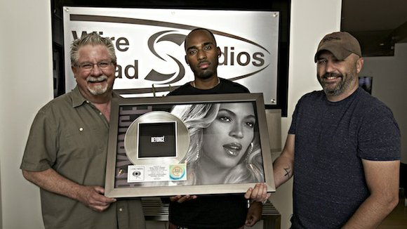 "Houston music engineer receives platinum plaque for Beyoncé""s self titlled album."