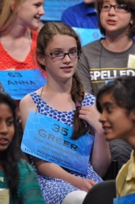 Greer Marshall, a D.C. sixth-grader representing The Washington Informer in the 87th annual Scripps National Spelling Bee at the Gaylord Hotel in Maryland's National Harbor, waits for the third round of the bee to start on May 28.
