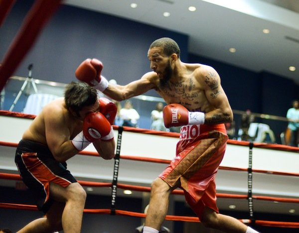 """Middleweight Daniel Gonzalez dodges a right hook from Larry """"The Cuban Assassin"""" Recio during a four-round bout at the Washington Convention Center in Northwest on May 31. Recio stopped Gonzalez in the second round."""