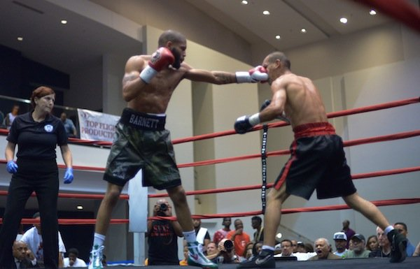 "Junior welterweight Ty Barnett lands a punch against Cosme ""Chino"" Rivera during a 10-round bout at the Washington Convention Center in Northwest on May 31."