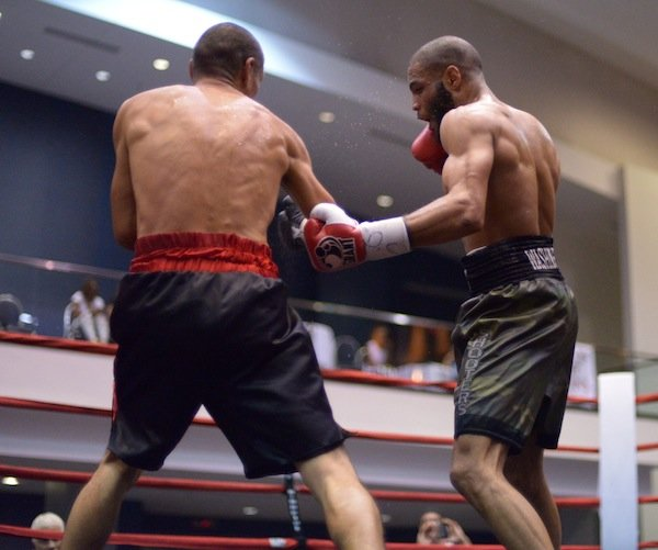 """Junior welterweight Ty Barnett lands a body blow against Cosme """"Chino"""" Rivera during a 10-round bout at the Washington Convention Center in Northwest on May 31."""