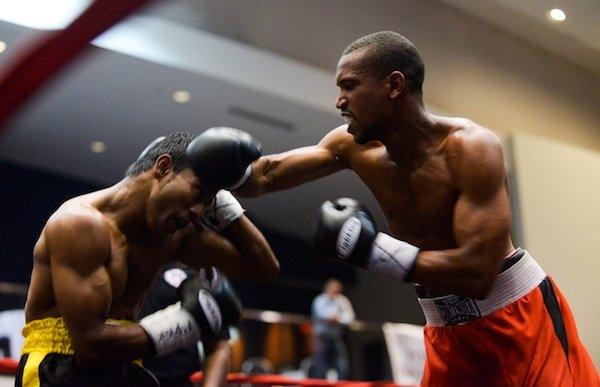 """Featherweight David Warren Huffman lands a hook against Nuwan """"The Lion"""" Jayakodi during a six-round bout on May 31 at the Washington Convention Center in Northwest. Jayakodi won by decision."""