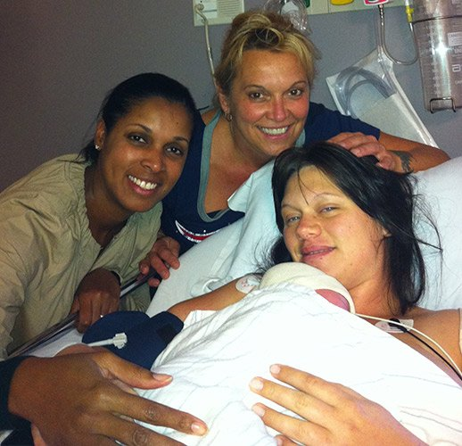 Pictured are Walker, Carlene Laurent, Taylor Schell and baby Desmond not long after his birth.
