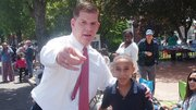 Mayor Martin Walsh spends a moment with Mattahunt Elementary School 4th grader Giovanni Bala.