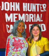 Sharon Cohen receiving the John Hunter Community Service Award from the John Hunter's Lolita Lowe.