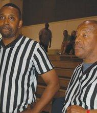 Referees Jeremiah Dalton (left) and Tony Jacobs check out the 2014 Portland Observer Joyce Washington Classic teams.