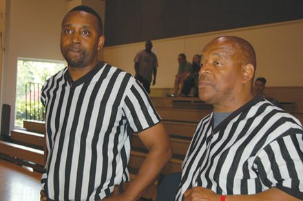 Referees Jeremiah Dalton (left) and Tony Jacobs check out the 2014 Portland Observer Joyce Washington Classic teams.