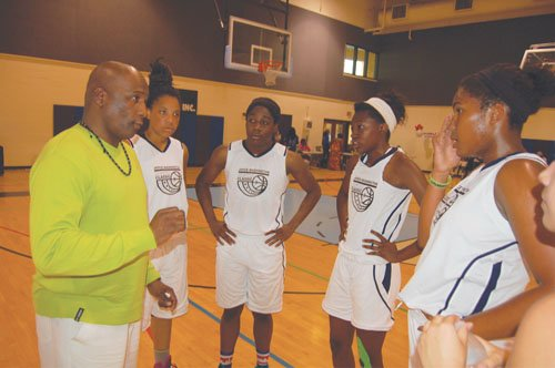 Coach Michael Mangum counsels his Joyce Washington Classic Team who would go on to beat the 503 Rebels in the Joyce Washington Classic Girls Championship by a score of 76-68.