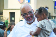Roger Logan hugs his granddaughter after his release from Prison for a crime he did not commit.