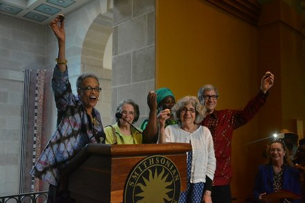 """From left: Johnnetta Betsch Cole, director of the Smithsonian National Museum of African Art; Lydia Robbins, wife of late museum founder Warren Robbins; and artist Mary Brody of Ghana raise their cupcakes in a toast during the """"African Art at 50"""" celebration at the museum in D.C. on June 3, 2014."""