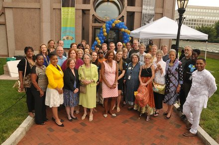 """The staff at the Smithsonian National Museum of African Art poses outside the museum in D.C. during the """"African Art at 50"""" celebration on June 3, 2014."""