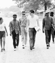 Freedom Summer volunteers and locals canvassing.