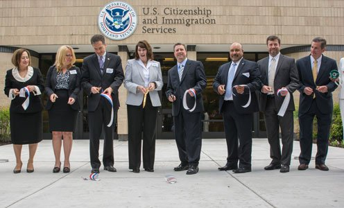 U.S. Citizenship and Immigration Services management and staff Lori Scialabba; Daniel Renaud; Katherine Patterson; Andrew Fontanez; Gregory Collett; Conrad Zaragoza; Sara Manzano-Diaz; and John Libaire at the ribbon cutting ceremony for the new field office in Baltimore on Friday, May 30, 2014.