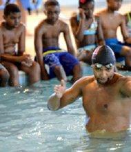 Olympic swimmer Cullen Jones teaches Baltimore children swimming fundamentals in 2013.