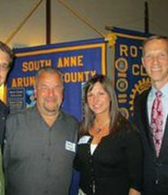 Lee Derrick, SAA Club; Donald and Lynette Entzian, honoree; and Chris Asher, club president.