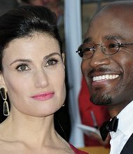 Actress and singer Idina Menzel, along with her husband, actor Taye Diggs, pose on the red carpet at the 19th Annual Screen Actors Guild Awards in Los Angeles, California on January 27, 2013.