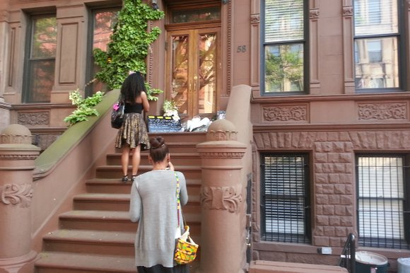 People left items at the Harlem home of Maya Angelou, who died May 28, 2014.