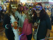 Revelers get into the spirit of the Big Easy and Mardi Gras at last year's New Orleans North fundraiser in downtown Joliet.