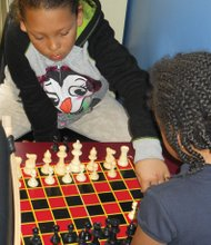 Kids enjoy the challenge of a chess match at the Blazer Boys and Girls Club on Northeast Martin Luther King Jr. Boulevard. Local officials are gearing up to keep kids out of trouble and active during summer break.