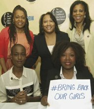 Sitting, L to R: International model Nnenna Agba and Nkechi Ogbodo, founder of Keichie's Project; standing rear, L to R: Avalyn Simon, president of NYCOBW; Laura Green, chair of NYCOHBW Arts Committee; and Cheryl G. Foster, member of NYCOHBW
