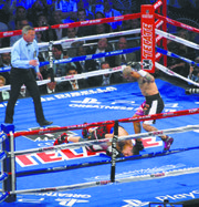 Cotto knocked a stretched-out Martinez to the canvas.