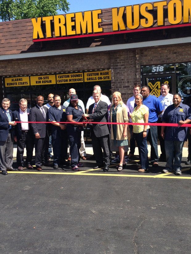 South Holland Village President Don A. De Graff (center) cut the ceremonial ribbon welcoming Xtreme Kustoms Wheels & Electronics, 518 E. 162nd St., South Holland, IL, to the community last week.
