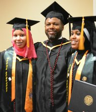 Baltimore City Community College graduates Jennah Abdul-Aziz (left) and her sister, Hajr (right) with fellow graduate— and Dad!— Muhammad Abdul-Aziz after receiving their associate degrees at BCCC's 65th Commencement, Saturday, June 7, 2014 at the Patricia and Arthur Modell Performing Arts Center at the Lyric.