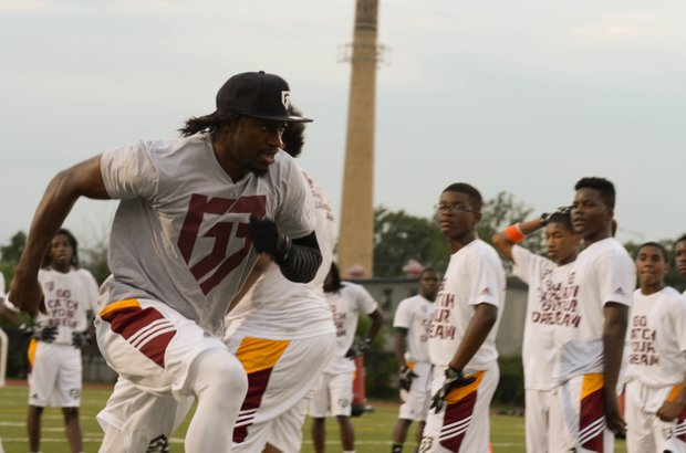 """Robert Griffin III runs a drill during his first-ever """"Friday Night Lights"""" football camp at Anacostia Senior High on Friday, June 13."""