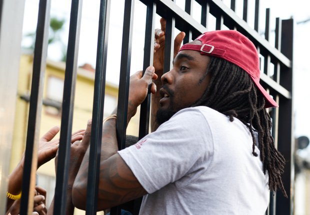 """D.C.-based rapper Wale greets fans at the gate during Robert Griffin III first-ever """"Friday Night Lights"""" football camp at Anacostia Senior High on Friday, June 13."""
