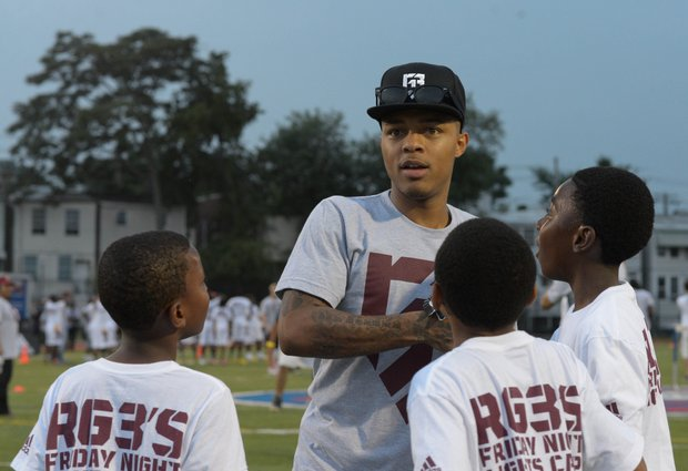 "Rapper Bow Wow was one of many stars on the field during Robert Griffin III's first-ever ""Friday Night Lights"" football camp at Anacostia Senior High on Friday, June 13."