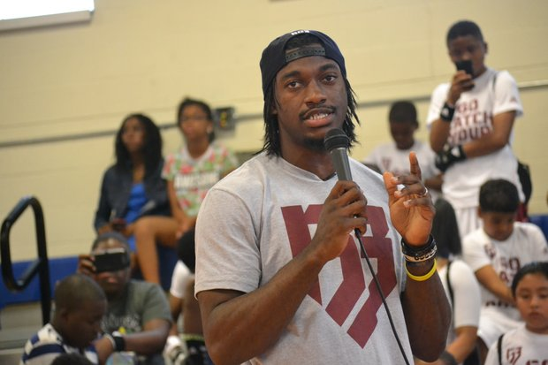 "Washington Redskins quarterback Robert Griffin III held his first ""Friday Nights Lights"" football camp at D.C.'s Anacostia High School on June 13. (Andrew Walker/Washington Redskins)"