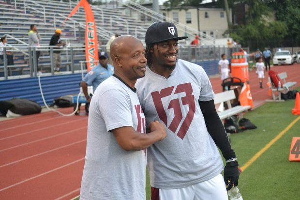 "Rapper Hammer (left) joins Washington Redskins quarterback Robert Griffin III for Griffin's ""Friday Nights Lights"" football camp at D.C.'s Anacostia High School on June 13. (Andrew Walker/Washington Redskins)"