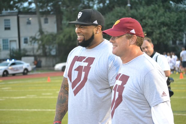 "Washington Redskins head coach Jay Gruden (right) was among the participants in quarterback Robert Griffin III's ""Friday Nights Lights"" football camp at D.C.'s Anacostia High School on June 13. (Andrew Walker/Washington Redskins)"