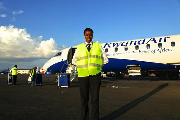 Esther Mbabazi wheels her bag towards the airstairs of the Boeing 737 sitting quietly on the tarmac at Kigali International ...