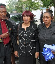 The Rev. Herbert Daughtry; Nelson's grandmother Shirley Nelson; and his mother, Monique Nelson