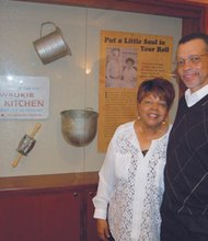 Husband and wife Hurtis and Dorothy Hadley stand next an exhibit featuring their former bakery, Milwaukie Pastry Kitchen, now on display at the Oregon Historical Society, downtown. The couple were the first black owners of a bakery in the state of Oregon.