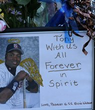 Fans remember baseballer Tony Gwynn at the base of a statue near Petco Park in San Diego, California.