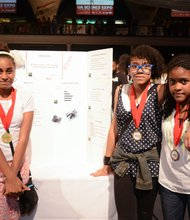 Pictured here are Kayla Torres, Dainea Wronge and Jordan Aponte and their project, which investigated the behavior of tufted puffins.
