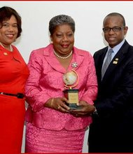 Jamaica's first female tourism director, Carrole Guntley (center), receives the CTO Lifetime Achievement Award from CTO Chairman Beverly Nicholson-Doty (left) and CTO Secretary General Hugh Riley