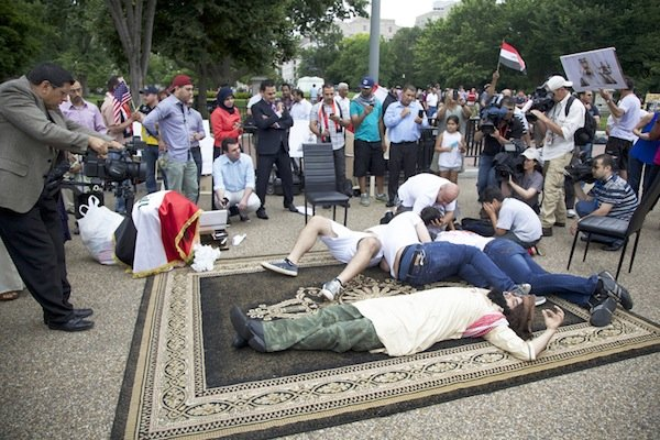 Iraqis depict an act of terrorism in front of the White House on June 21 during a demonstration against new military action in Iraq.