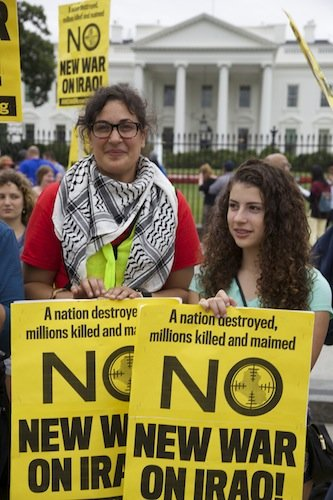 Heather Bennom, 33, and Rose Marsh, 14, hold signs in front of the White House on June 21 during a demonstration against new military action in Iraq.