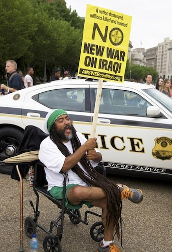 A man participates in a demonstration against new military action in Iraq on June 21 in front of the White House.