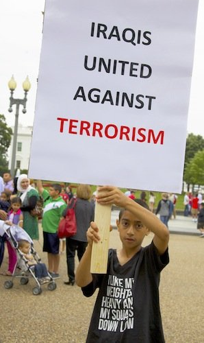 Munther Himmad, 9, holds a sign in front of the White House on June 21 during a demonstration against new military action in Iraq.