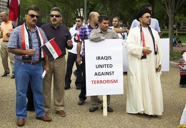 A group of Iraqis from Virginia stand on Pennsylvania Avenue in front of the White House on June 21 during a demonstration against new military action in Iraq.