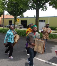 Musicians play traditional African instruments along the Juneteenth parade route