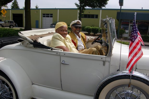 Paul Knauls of Geneva's Shear Perfection Barber and  'Mother of Juneteenth' in Portland' Clara Peoples ride in style during the Juneteenth parade.